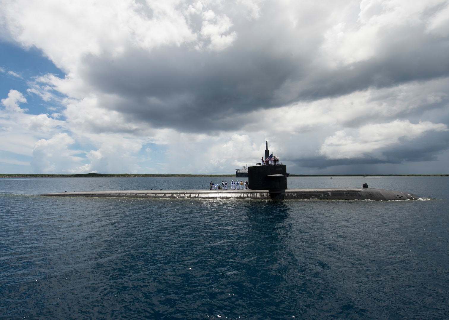The Los Angeles-class fast-attack submarine USS Oklahoma City (SSN 723) returns to its homeport of Apra Harbor, Guam. Oklahoma City is one of four forward-deployed submarines assigned to Submarine Squadron 15.