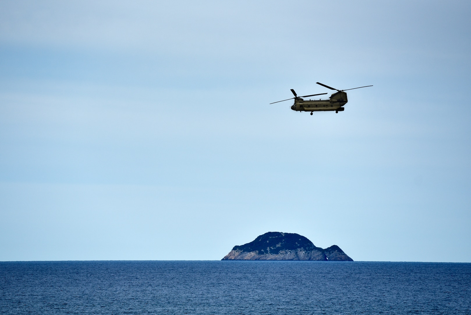 A CH-53 helicopter with the Australian Army brings role-players to the HMAS Canberra during Exercise Sea Raider at Sea June 17, 2018. The helicopters and soldiers were taking part in non-combatant evacuation operations as part of Ex Sea Series 18. The series is designed to train Australian Forces and get them amphibious ready. U.S. Marines and Sailors with Marine Rotational Force - Darwin 18 are working alongside the ADF as part of the Amphibious Task Group.