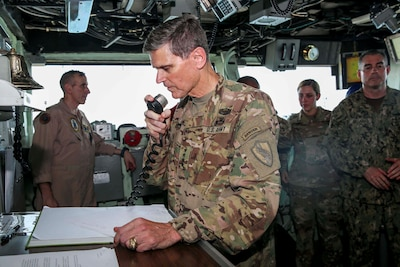 U.S. Army Gen. Joseph Votel, commander, U.S. Central Command, addresses the Marines and Sailors aboard the Wasp-class amphibious assault ship USS Iwo Jima (LHD 7), June 22, 2018. Votel, Vice Adm. Scott Stearney, commander, U.S. Naval Forces Central Command, and other distinguished visitors took a tour of Iwo Jima and spoke with crew members and Marines with the 26th Marine Expeditionary Unit, who are currently deployed to the U.S. 5th Fleet of operations in support of maritime security operations to reassure allies and partners and preserve the freedom of navigation and the free flow of commerce in the region. (U.S. Marine Corps photo by Cpl. Jon Sosner/Released)