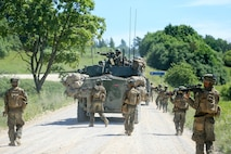 U.S. Marines from 1st Battalion, 6th Marines and 4th Light Armored Reconnaissance Battalion advance towards their objective during Exercise Saber Strike 18