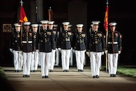 Marines with Marine Barracks Washington D.C. march down Center Walk during a Friday Evening Parade at the Barracks, June 29, 2018. The guest of honor for the ceremony was the Under Secretary of the Navy, Thomas B. Modly, and the hosting official was the Assistant Commandant of the Marine Corps, Gen. Glenn M. Walters.
