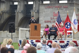 Maj. Justin Toole, U.S. Army Corps of Engineers Nashville District deputy commander, talks about project benefits during the 50th Anniversary of J. Percy Priest Dam and Reservoir at the dam in Nashville, Tenn., June 29, 2018.  The major said President Lyndon B. Johnson's vision of reducing flooding, providing water, creating hydropower, and recreation has come to fruition over the past 50 years. (USACE Photo by Lee Roberts)