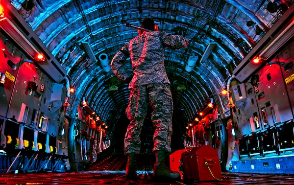 Senior Airman checks inside of C-17 Globemaster III before beginning preflight inspection March 27, 2013, at Wright-Patterson Air Force Base, Ohio (U.S. Air Force/Mikhail Berlin)