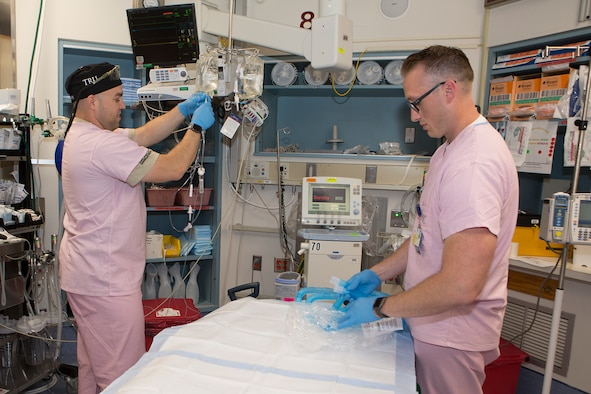 Maj. Shane Runyon (right), Baltimore's Center for the Sustainment of Trauma and Readiness Skills (C-STARS) program deputy director, and Master Sgt. Sean Patterson, a respiratory therapist and superintendent of C-STARS Baltimore, set up for patient arrival at the Trauma Resuscitation Unit (TRU) at the University of Maryland Medical Center, Baltimore, June 13, 2018. The U.S. Air Force's C-STARS Baltimore program partners with the R Cowley Shock Trauma Center at the University of Maryland Medical Center to ensure medical Airmen train on the latest trauma care techniques. These techniques prepare medical Airmen to treat trauma patients in a deployed setting. (Courtesy photo)