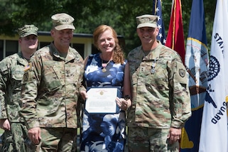 Lt. Gen. Jeffrey Buchanan (left) poses with Maj. Gen. Richard Gallant (right) and his wife, Carol Gallant (center) during a change of command ceremony held at Seay Plaza on Fort Eustis June 29. Gallant was relieved of command of Joint Task Force Civil Support by Maj. Gen. William Hall. (Official DoD photo by Christopher Thompson/released)