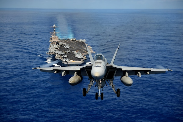 F/A-18E Super Hornet from Tophatters of Strike Fighter Squadron (VFA) 14 participates in airpower demonstration over aircraft carrier USS John C. Stennis, Pacific Ocean, April 24, 2013 (U.S. Navy/Ignacio D. Perez)