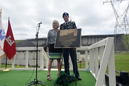 Harriett Priest, daughter of the late Congressman J. Percy Priest, and Maj. Justin Toole, U.S. Army Corps of Engineers Nashville District deputy commander, unveil a commemorative plaque during the 50th Anniversary of J. Percy Priest Dam and Reservoir at the dam in Nashville, Tenn., June 29, 2018. (USACE Photo by Lee Roberts)