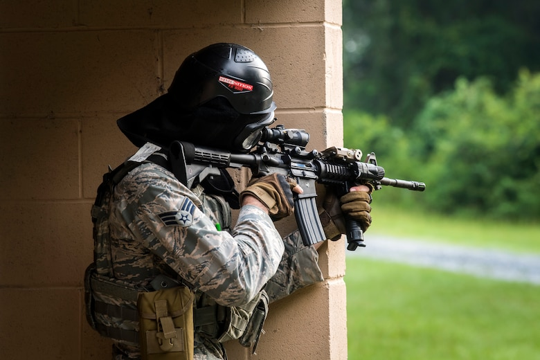 An Airman from the 23d Security Forces Squadron (SFS) fires an M4 carbine during a Force on Force training scenario, June 29, 2018, at Moody Air Force Base, Ga. This training was held to ensure SFS Airmen are proficient in various tactics and procedures such as: building clear out, team movements, hostage rescue and properly applying cover fire. The scenario required Airmen to maneuver through multiple buildings to rescue a simulated victim guarded by opposing forces. (U.S. Air Force photo Airman 1st Class Eugene Oliver)