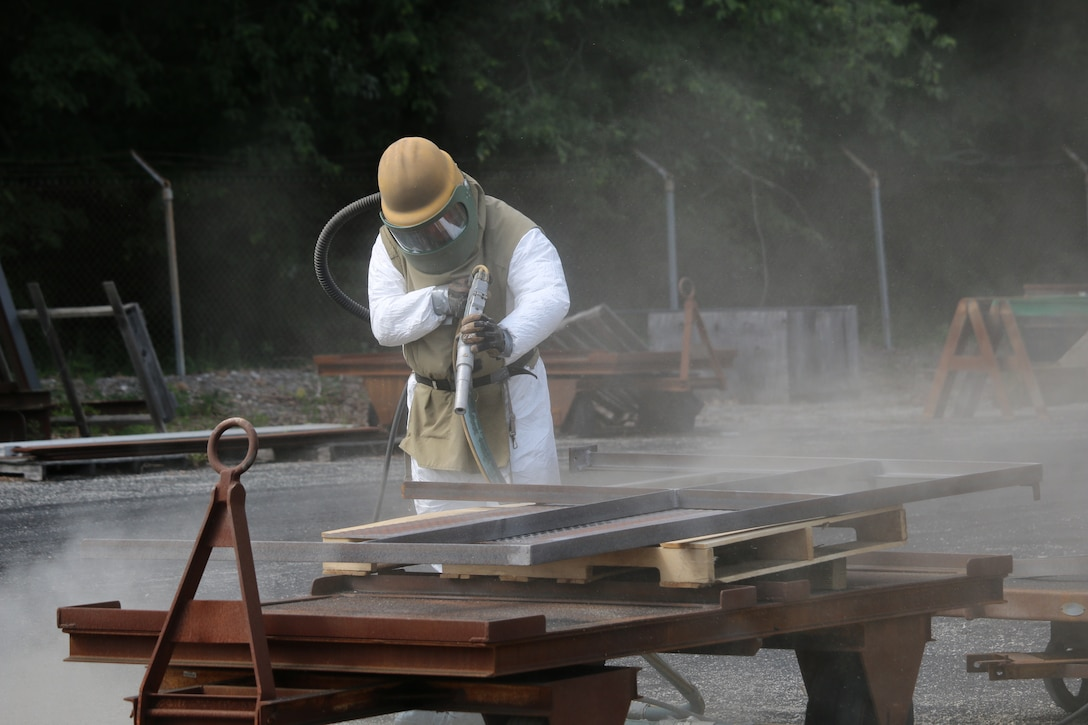 Paint Shop team member C.D. Hobbs completes sandblasting work at Arnold Air Force Base. Sandblasting is one of many duties charged to the Paint Shop at Arnold AFB. (U.S. Air Force photo/Bradley Hicks)