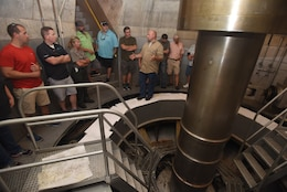 A public tour group gets an up-close view of a generator shaft during a tour of the hydropower plant as part of the 50th Anniversary of J. Percy Priest Dam and Reservoir in Nashville, Tenn., June 29, 2018. (USACE Photo by Lee Roberts)