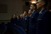 Specialized Undergraduate Pilot Training Class 18-11 stands before their graduation ceremony June 29, 2018, on Columbus Air Force Base, Mississippi. Every three weeks a pilot graduation ceremony is takes place to welcome the next generation of military aviators. (U.S. Air Force photo by Airman 1st Class Keith Holcomb)