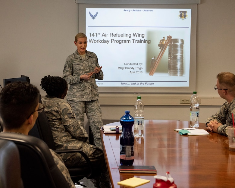 MSgt Sgt. Brandy Trego, budget analyst with the 141st Air Refueling Wing, briefs Airmen from the 52nd Fighter Wing's comptroller flight on Air National Guard processes during training April 17, 2018 at Spangdahlem Air Base, Germany. Trego was one of nearly 20 Guardsmen that had the opportunity to complete their annual training alongside their active duty counterparts in early April at Spangdahlem.