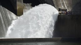 A tour group watches water spray into the tailwater at J. Percy Priest Dam during a public tour as part of the 50th Anniversary of J. Percy Priest Dam and Reservoir in Nashville, Tenn., June 29, 2018. The spray adds oxygen into the water in the Stones River to benefit aquatic life downstream. (USACE Photo by Lee Roberts)