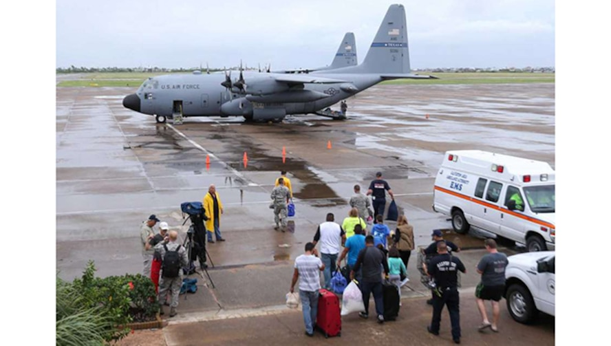Dickinson flood evacuees boarding an airplane at Scholes International Airport on Monday, August 28, 2017, in Galveston. Texas Air National Guard planes were taking these flood evacuees to other cities after they spent Sunday night at a Galveston shelter, an example of how citizen airmen help during disasters.