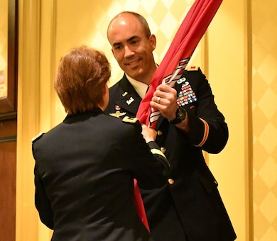 Col. Sebastien P. Joly receives the U.S. Army Corps of Engineers flag from Brigadier General Diana M. Holland during the USACE Mobile District Change of Command ceremony on June 29, 2018 at the Renaissance Riverview Hotel in Mobile, Al. Joly became the 53rd commander of the Mobile District.
