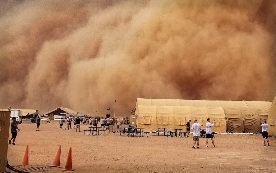 U.S. service members observe and take photos of a sand storm at Nigerien Air Base 201, Niger, June 24, 2018. Sand storms are a normal occurrence during the summer seasons in Northwest Africa. (U.S. Air Force courtesy photo by Airman 1st Class Anthony Montero)