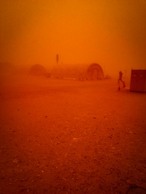 Visibility transitions to a red tint as a sand storm passes through the region at Nigerien Air Base 201, Niger, June 24, 2018. This was the largest sand storm of the season so far, with sustained winds in excess of 50 knots. (U.S. Air Force courtesy photo by Airman 1st Class Anthony Montero)