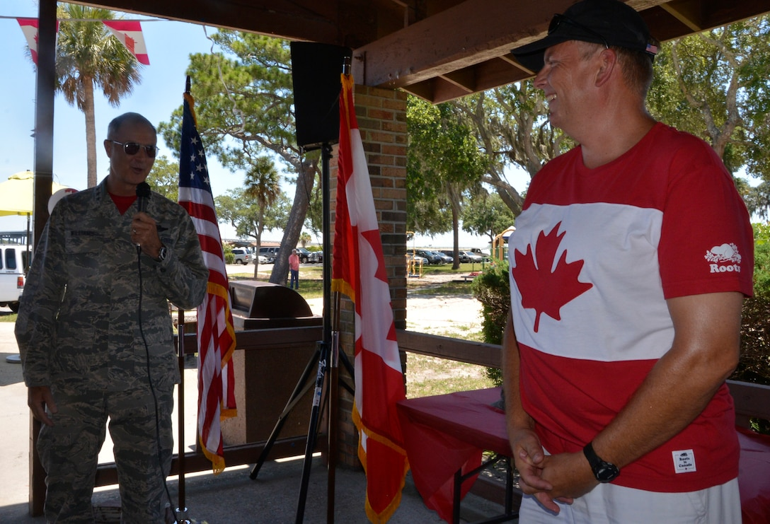 Lt. Gen. R. Scott Williams, Commander, 1st Air Force (Air Forces Northern) – Continental U.S. Region, makes opening remarks much enjoyed by Royal Canadian Air Force LCol Brian Murray, the CONR Canadian Detachment commander, during locally-observed Canada Day festivities at Bonita BayJune 29. Officially celebrated July 1, Canada Day celebrates the Constitution Act, which in 1867, brought together the colonies of the Province of Canada, Nova Scotia and New Brunswick into what is now known as Canada. (U.S. Air Force Photo by Mary McHale)