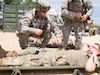 U.S. Army Reserve Soldiers with 865th Combat Support Hospital, based in Utica, N.Y., perform patient evaluations as part of a mass casualty exercise during Regional Medic CSTX 86-18-04, at Tactical Training Base Justice on Fort McCoy, Wis., June 23, 2018. CSTX 86-18-04 is a Combat Support Training Exercise that ensures America's Army Reserve units and Soldiers are trained and ready to deploy on short-notice and bring capable, combat-ready, and lethal firepower in support of the Army and our joint partners anywhere in the world. (U.S. Army Reserve photo by Staff Sgt. Eric W. Jones)