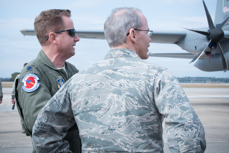 Lt. Col. Sean Cross, 53rd Weather Reconnaissance Squadron pilot, speaks to Maj. Gen. Robert LaBrutta, 2nd Air Force commander, during a 403rd Wing immersion tour Feb. 3 at Keesler Air Force Base, Mississippi. (U.S. Air Force photo/Staff Sgt. Heather Heiney)