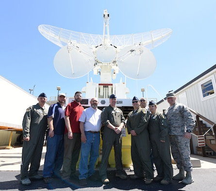 28th Bomb Wing leadership and radar technicians stand in front of a multiple-input single-output radar at the Powder River Training Complex in Colony, Wyoming, June 21, 2018.  Ellsworth leadership has been working with the community to help overcome obstacles and form a stronger partnership that would be mutually beneficial to both parties. (U.S. Air Force phot by Airman 1st Class Thomas Karol)