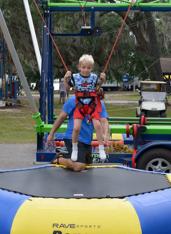 Brody Lindskog, son of U.S. Air Force Tech. Sgt. Levi Lindskog, 4th Space Launch Squadron missile and space system maintenance, Vandenberg Air Force Base, California, jumps on a trampoline during Freedom Fest at Marina Park on Keesler Air Force Base, Mississippi, June 30, 2018. The event included carnival rides, a burger cook-off, hot wings and watermelon eating competitions and a fireworks display. (U.S. Air Force photo by Andre' Askew)