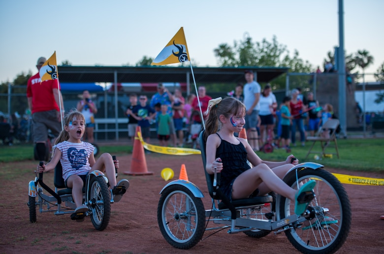 Children participate in a tricycle race during the annual Freedom Fest celebration June 29, 2018 at Luke Air Force Base, Ariz. Freedom Fest is an event that offers a variety of games and activities for military members and their families to enjoy in celebration of Independence Day. (U.S. Air Force photo by Airman 1st Class Alexander Cook)