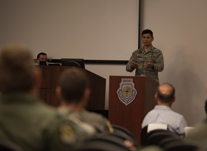Lt. Col. Douglas Medley, 32nd Weapons Squadron commander, gives a speech during an assumption of command ceremony at Nellis Air Force Base, Nevada, June 28, 2018. Medley graduated from the U.S. Air Force Weapons School in 2012 and is returning as the 32nd WPS squadron commander, focusing on Cyber Warfare Operations Weapons Instructor Course. (U.S. Air Force photo by Airman 1st Class Andrew D. Sarver)