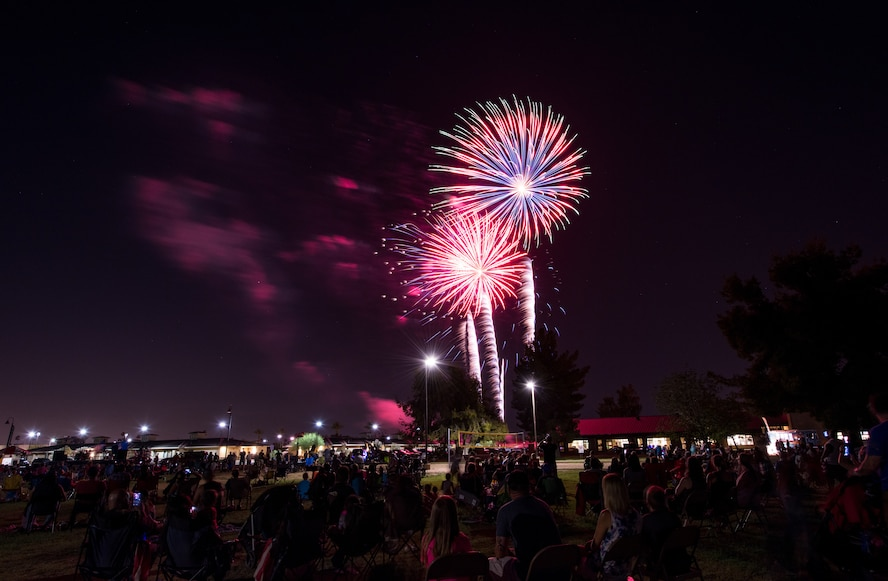 Thunderbolts watch as a display of fireworks light up the sky over Fowler Park during the annual Freedom Fest celebration June 29, 2018 at Luke Air Force Base, Ariz. Hundreds of Thunderbolts gathered to watch the 15-minute display as the Arizona night sky was filled with pyrotechnic wonders. (U.S. Air Force photo by Airman 1st Class Alexander Cook)