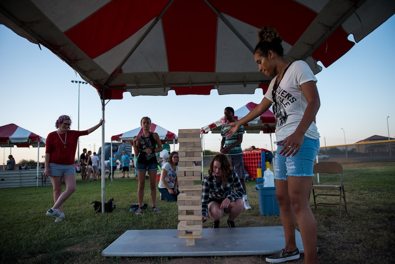 Thunderbolts play a game with wooden blocks during the annual Freedom Fest celebration June 29, 2018 at Luke Air Force Base, Ariz. Hundreds of military families attended the festival to participate in games and activities in celebration of American independence. (U.S. Air Force photo by Airman 1st Class Alexander Cook)