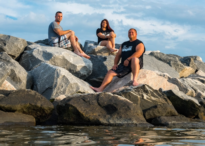 U.S. Air Force Tech. Sgt. Richard Penny, Ashley Staley and Adam Bradshaw sit on a rock bank on Fort Monroe Beach, Virginia, June 28, 2018, where they had saved a young girl from drowning earlier that year. Penny, Staley and Bradshaw rescued the girl from drowning near the rock bank on May 13, 2018 and received the Hampton, Virginia, Citizen Lifesaving certificate June 7, 2018. Penny works as the 633rd Air Base Wing Inspector General management internal control toolset administrator and special access program manager. (U.S. Air Force photo by Airman 1st Class Anthony Nin Leclerec)