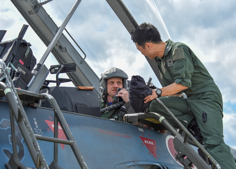 U.S. Air Force Col. R. Scott Jobe, the 35th Fighter Wing commander, speaks with Japan Air Self-Defense Force 1st Lt. Yoshinobu Sasaki, a 3rd Air Wing F-2 pilot, before a familiarization flight at Misawa Air Base, Japan, June 22, 2018. The flight gave Jobe, an F-16 Fighting Falcon pilot, the opportunity to experience the Mitsubishi  F-2 mission set. (U.S. Air Force photo by Airman 1st Class Collette Brooks)