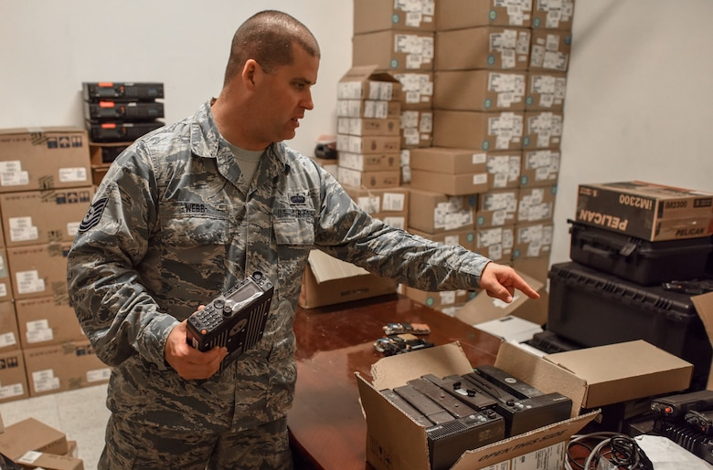 Tech. Sgt. Webb unboxes mobile APX 6500 mobile radios