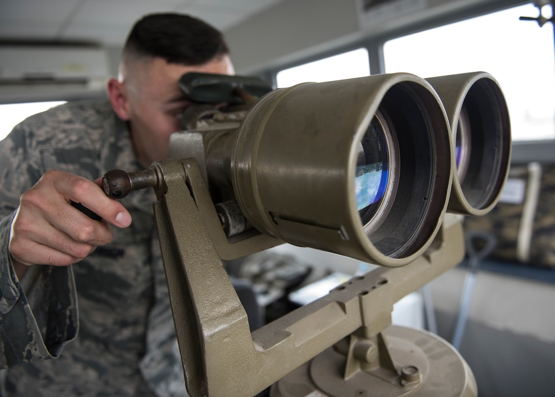 INCIRLIK AIR BASE, Turkey – U.S. Air Force Staff Sgt. Cody Hutchison, 39th Security Forces Squadron contingency operations assistant NCO in charge, looks through binoculars on top of a watch tower at Incirlik Air Base, Turkey, June 21, 2018.