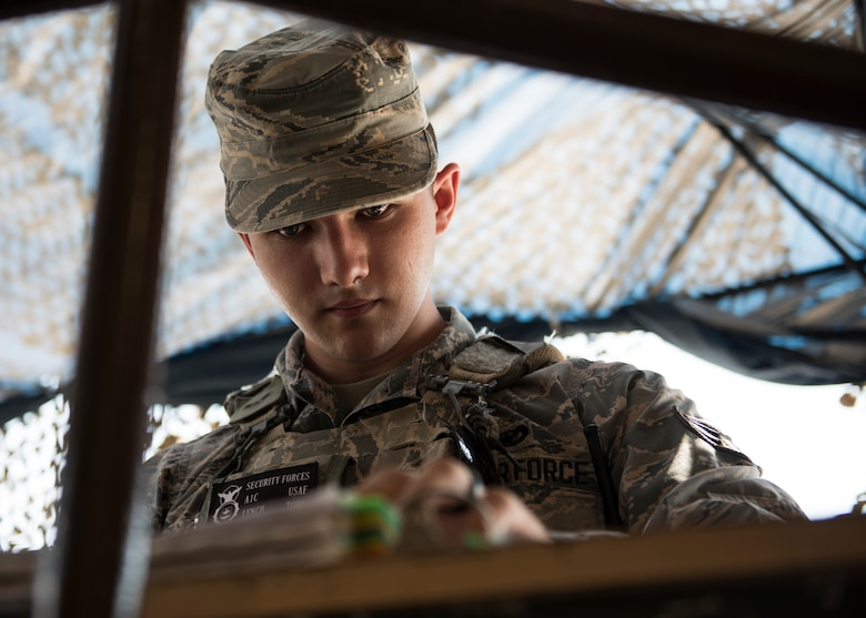 INCIRLIK AIR BASE, Turkey – U.S. Air Force Airman 1st Class Tory Lynch, a 39th Security Forces Squadron contingency member, inspects ID cards at Incirlik Air Base, Turkey, June 21, 2018.