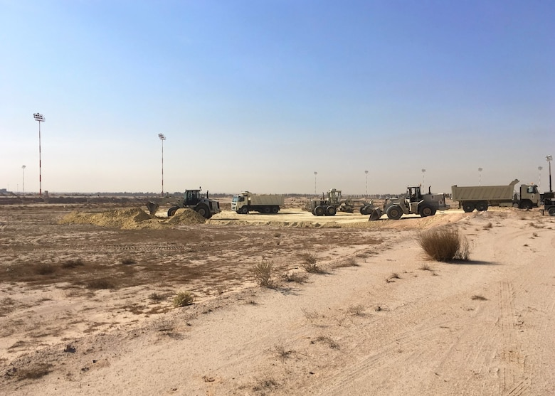 Airmen from the 386th Expeditionary Civil Engineer Squadron conduct a land survey at Cargo City, located at Abdullah Al Mubarak Air Base, Kuwait, November 11th, 2017. Before building the future home of the 387th Air Expeditionary Group, 5th Expeditionary Air Mobility Squadron, and other Joint and Coalition Partners, the land needed to be filled in, graded, and compacted, as the designated site was originally 10 feet below the ramp. (Courtesy photo)