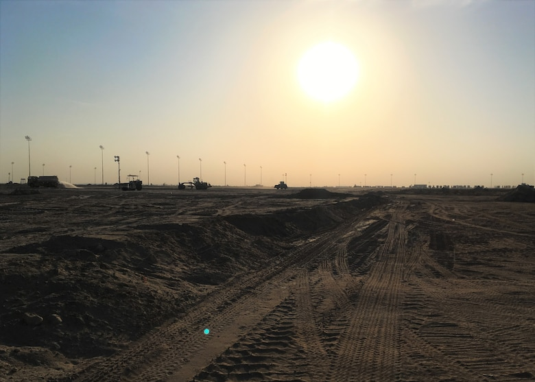 A day of back-filling comes to an end at Cargo City, on Kuwait International Airport, Kuwait, December 18, 2017. Before building the future Aerial Port of Debarkation, the 386th Expeditionary Civil Engineer Squadron, 1st Expeditionary Civil Engineer Group, 387th Expeditionary Support Squadron had to make the site suitable for construction. (Courtesy photo)