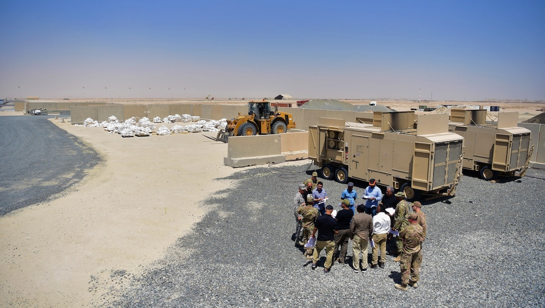 Members from the 386th Expeditionary Contracting Squadron speak to prospective clients at Abdullah Al Mubarak Air Base, Kuwait, June 25, 2018. The 386 ECONS is responsible for awarding contracts to local vendors for services rendered and product acquisition for the Air Force Central Command area of responsibility. (U.S. Air Force photo by Staff Sgt. Christopher Stoltz)