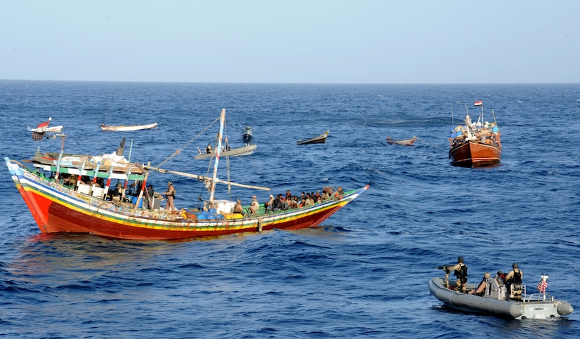 Visit, board, search, and seizure team from USS Halsey approaches two Yemeni dhows intercepted during routine maritime security operations, Gulf of Aden, February 5, 2012 (U.S. Navy/Krishna M. Jackson)