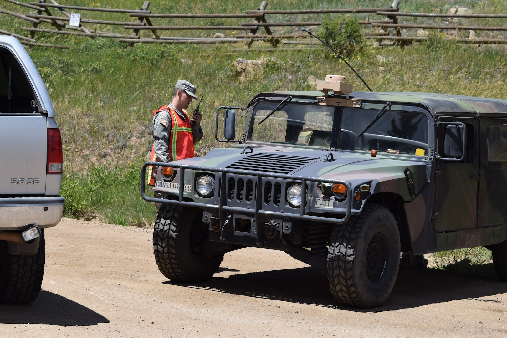 Colorado Army National Guardsmen, Private Joshua Breeden, radios higher authorities for an authorization tp pass for a civilian traveling through a road closer. Breeden is a member of Task Force Security assisting Boulder County Sheriff's Office with Cold Springs fire relief efforts in Boulder Colo., July 11, 2016.