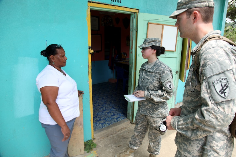 Soldiers with 399th Tactical Psychological Operations Company ask permission of local school headmaster to post information outside school in Cristo Rey, Belize, April 24, 2017 (U.S. Army/Joshua E. Powell)