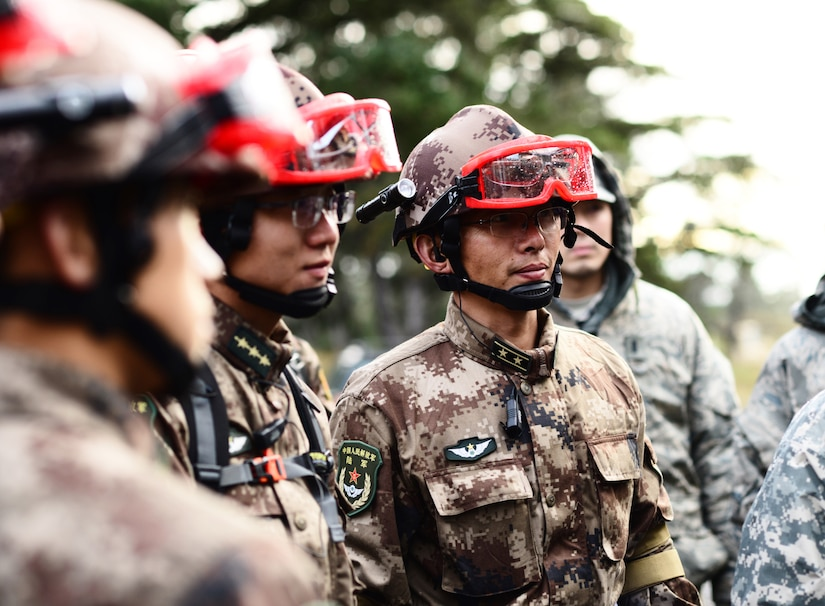 Soldiers from People's Liberation Army listen to briefing in preparation for search and extraction exchange during 13th annual U.S.-China Disaster Management Exchange at Camp Rilea Armed Forces Training Center, Warrenton, Oregon, November 16, 2017 (U.S. Army/April Davis)