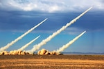 PHL-03 Multiple Launch Rocket Systems attached to army brigade with People's Liberation Army Eastern Theater Command fire salvo of 300mm surface-to-surface rockets at simulated ground targetsduring live-fire training exercise in Gobi Desert of Northwest China, August 8, 2017 (Courtesy China Military Online/Jiang Xiaoliang)