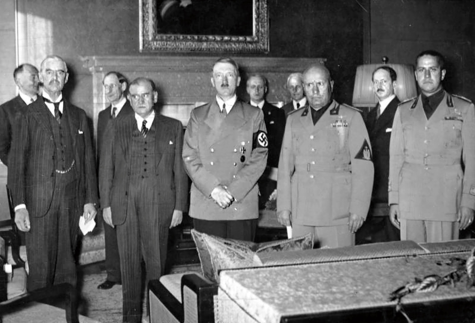 Front row, left to right, British Prime Minister (PM) Neville Chamberlain, French PM Édouard Daladier, German Chancellor Adolf Hitler, Italian PM Benito Mussolini, and Italian Foreign Minister Count Ciano as they prepare to sign Munich Agreement, September 29, 1938 (Courtesy German Federal Archive)