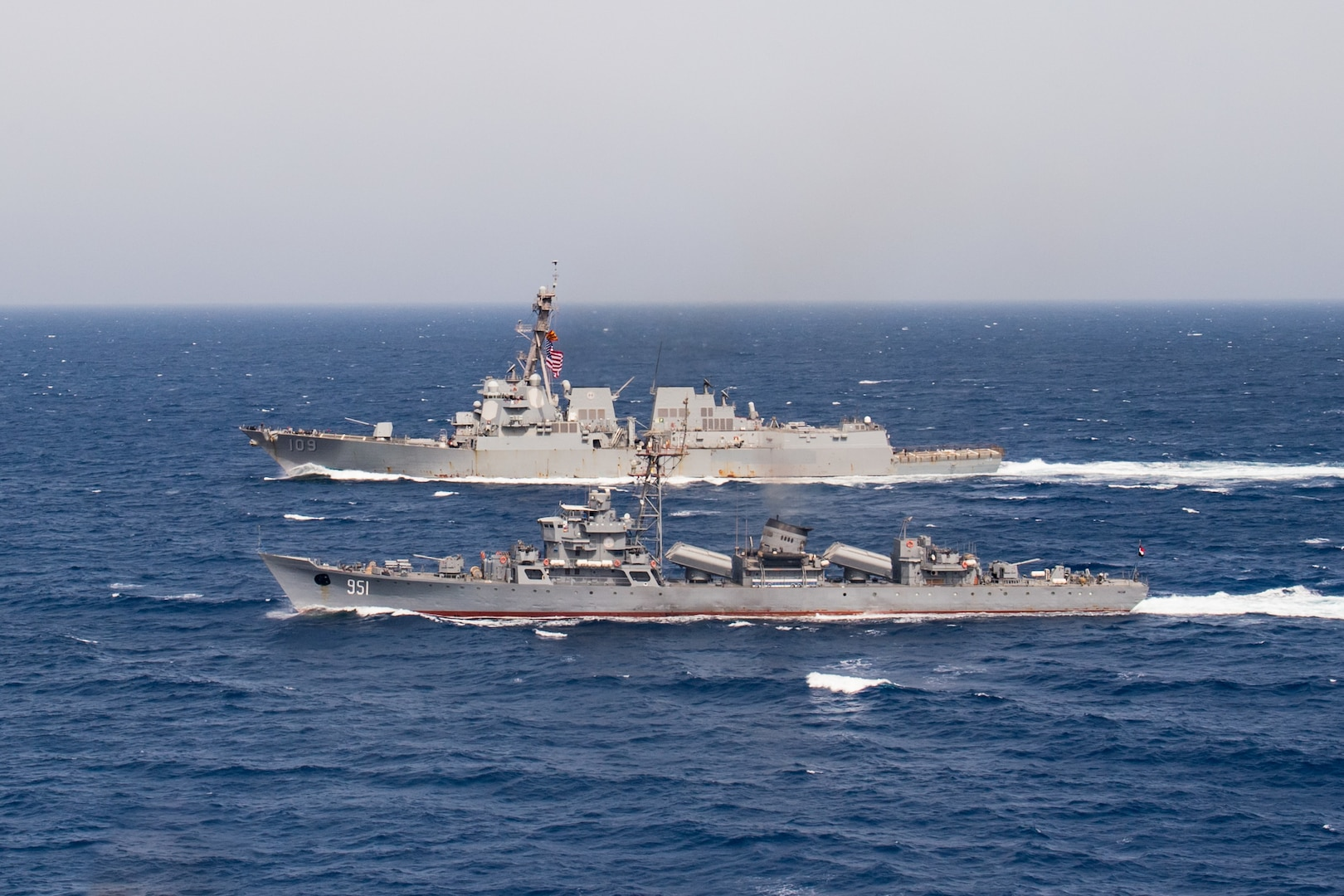The Egyptian Navy ship El Zafer (F951), front, steams alongside the guided-missile destroyer USS Jason Dunham (DDG 109) during a passing exercise (PASSEX).  Dunham is deployed to the U.S. 5th Fleet area of operations in support of naval operations to ensure maritime stability and security in the Central region, connecting the Mediterranean and the Pacific through the western Indian Ocean and three strategic choke points. (U.S. Navy photo by Mass Communication Specialist 3rd Class Jonathan Clay/Released)