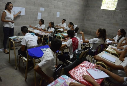 Liliana Vasquez teaches eighth graders English in a makeshift school at El Amato, El Salvador. Soldiers from the U.S. and El Salvador are building an addition to a school at Santa Rita, June 25, 2018, in La Paz Department, El Salvador, which should be finished by the end of July 2018.