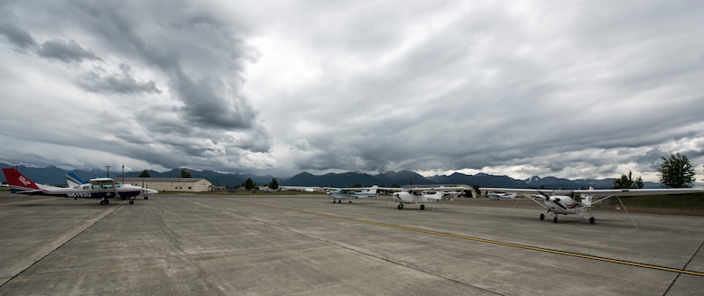 Elmendorf Aero Club General Aviation and privately owned airplanes are parked in rentable spaces near the clubs' hangar at Joint Base Elmendorf-Richardson, Alaska, June 28, 2018. The club has more than 15 rentable spaces available outside and five inside for personal aircraft storage.