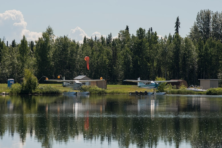 Private aircraft are docked at the Elmendorf Aero club water landing area and floating docks on Lower Sixmile Lake at Joint Base Elmendorf-Richardson, Alaska, July 2, 2018. The club offers rentable spaces for seaplanes, flying boats, and amphibious aircraft designed to take off and alight on water.