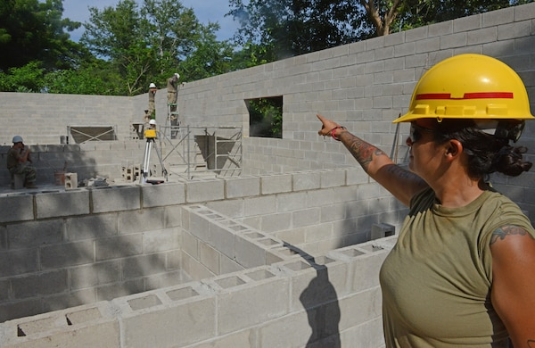 Staff Sgt. Cristin Baughman is the non-commissioned officer in charge of a group of 30 Soldiers from the 4th Engineer Battalion, Fort Carson, Colorado, directs construction of a three-classroom cinderblock structure for elementary and middle school children at Santa Rita, El Salvador, June 25, 2018, in La Paz Department, El Salvador.