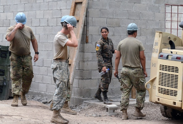 1st Lt. Yamilet Estefani Alabi, a Salvadoran soldier, directs U.S. Soldiers at a construction site in El Amato, June 25, 2018, in La Paz Department, El Salvador. The construction is part of U.S. Army South-led Beyond the Horizon exercise lasting May 12 through Aug. 4, 2018.
